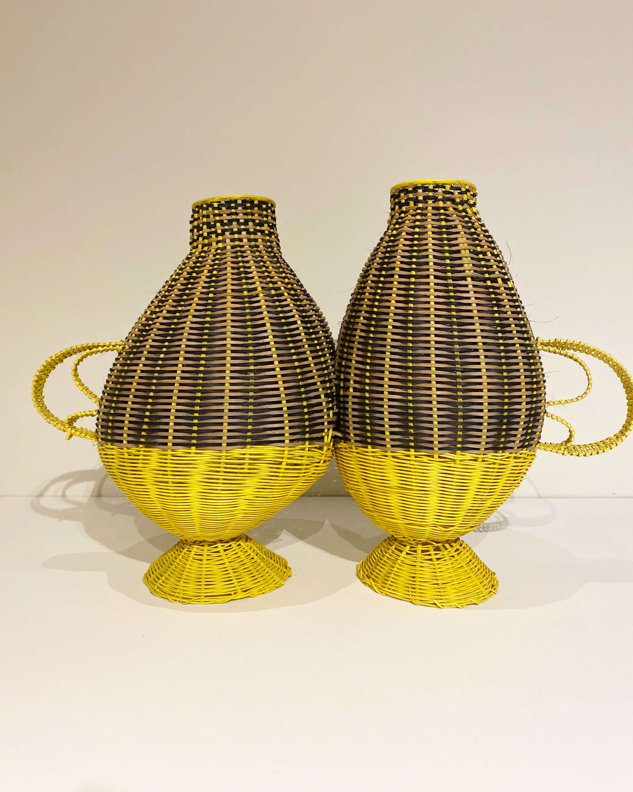 yellow hand woven vessels