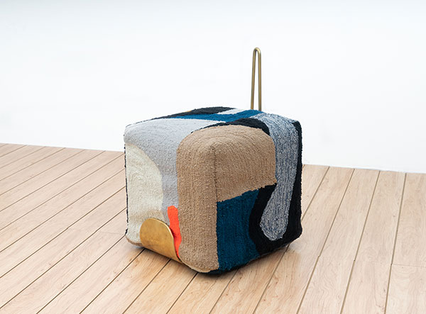 cube shaped hand tufted chair with metal stand
