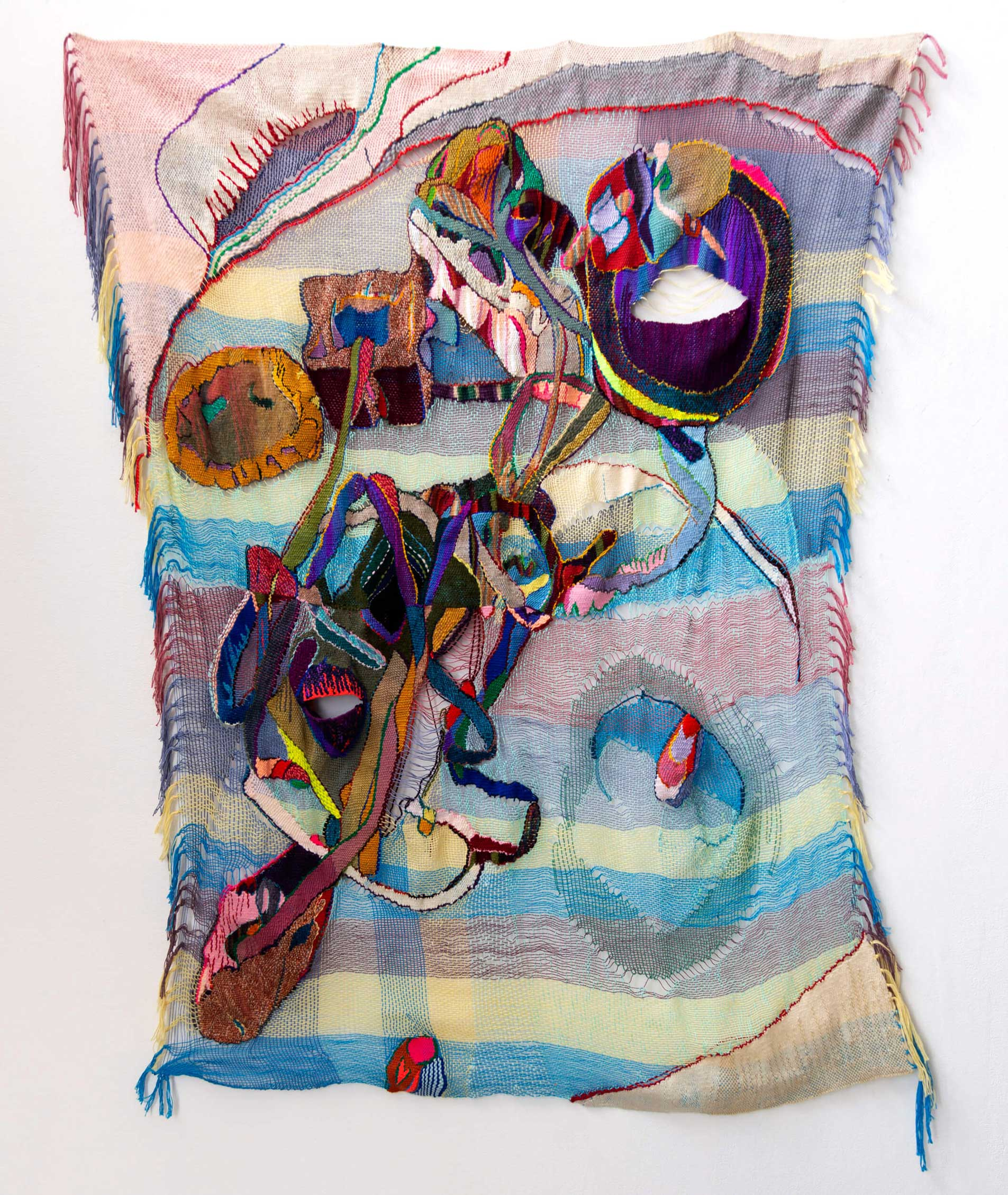 Large, vertical orientation colorful weaving. Abstract, three-dimensional woven shapes adorn the surface.